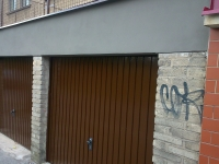 Oprava fasády a nátěr vrat